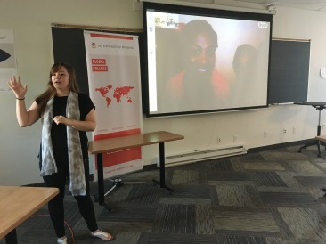 Katrina Leclerc from Global Network for Peacebuilders introduces the class to Congolese women participating in the Girl Ambassador's for Peace program via Skype.