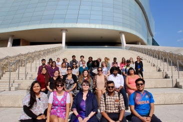 2018 Human Rights UniverCITY Summer Institute students pose in front of the Canadian Museum for Human Rights.