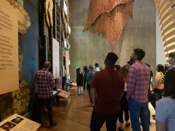Students listen to CMHR interpreter Amber in the Indigenous Perspectives Gallery