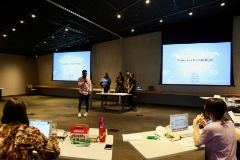 Student present on water rights as part of group projects