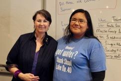 """Sentator McPhedran poses with student wearing a shirt that reads """" Winnipeg! got water? Thank Shoal Lake No. 40"""""""