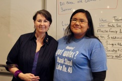"Sentator McPhedran poses with student wearing a shirt that reads "" Winnipeg! got water? Thank Shoal Lake No. 40"""