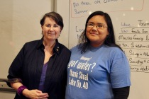 "Senator and Course Director Marilou McPhedran stands with 2018 student. The student shirt states "" Winnipeg! got water? Thank Shoal Lake No. 40."""