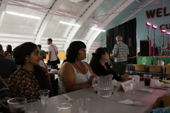 Students watch the Afro-Caribbean Pavilion at Folklorama