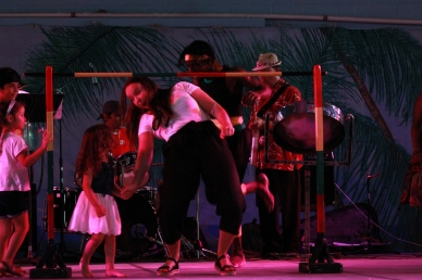 Anne, Administrative Assistant, does limbo at the Afro-Caribbean Pavilion