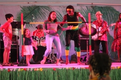 Student does limbo on stage at the Afro-Caribbean Pavilion