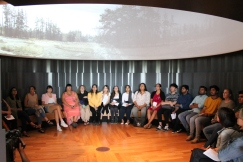 Students watch video in Indigenous Perspectives gallery