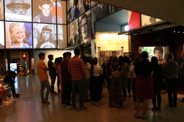Students exploring the Canadian Journeys gallery