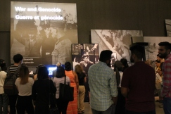 Students look on at the Examining the Holocaust exhibit