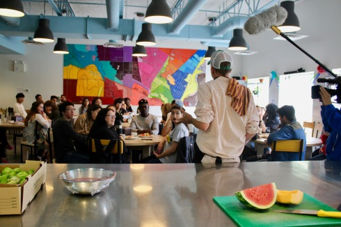 Students sit around table at NorWest Community Food Centre with Community Chef Grant Mitchell