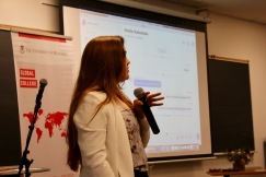 Katrina Leclerc, program coordinator for the Global Network of Women Peacebuilders, presents in classroom
