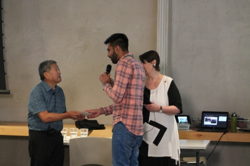 Student gives thank-you to Dr. Art Miki while Senator McPhedran looks on