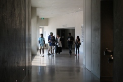 Students and Senator McPhedran walk down hallway in CMHR