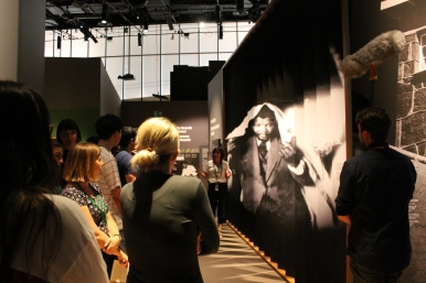 students look at photo of Mandela in the Mandela: Struggle for Freedom exhibit
