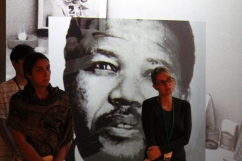 two students stand in front of portrait in the Mandela: Struggle for Freedom exhibit
