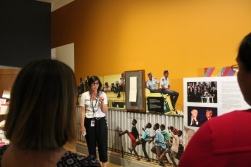 Isabelle Masson speaks in front of display in Mandela: Struggle for Freedom