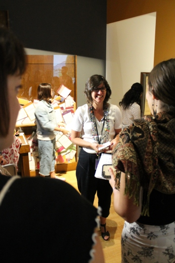 Isabelle Masson smiles at students in the Mandela: Struggle for Freedom exhibit