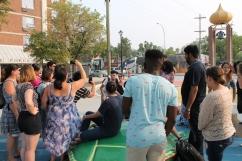 student capture photos of Senator McPhedran and Community Organizer, Michael Redhead Champagne