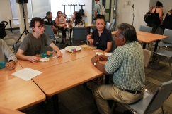 Students and community members engage at class Potluck