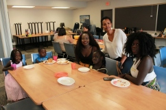 Family of student poses for a photo at the class Potluck
