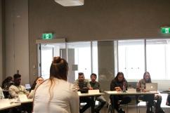 Katrina Leclerc, executive assistant to Senator McPhedran, speaks in front of classroom