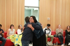Elder Wally Chartrand hugs student at Mawi Wi Chi Itata Centre