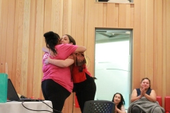 Youth Program Coordinator, Crystal Leach, hugs student at Mawi Wi Chi Itata Centre