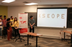 Student presents in front of class as part of group project